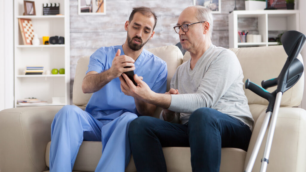 A doctor and patient use an Ad Astra phone interpreting services.